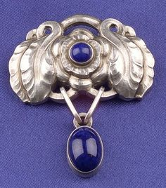 Sterling Silver and Lapis Brooch, Georg Jensen, with flower and leaf motifs, bezel-set lapis highlights, lg. 1 3/4 in., no. 193, signed.