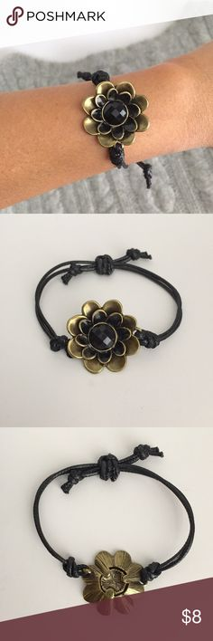 🔹Handmade🔹 adjustable leather & bronze bracelet Adjustable bracelet made from waxed leather cord with bronze flower charm. Adjustable up to 8in. Handmade made and unique! Jewelry Bracelets