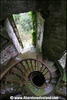 Stairs: Spiral staircase in abandoned Foaty Tower, County Cork, Ireland. Old Buildings, Abandoned Buildings, Abandoned Places, Abandoned Castles, Haunted Places, Stairway To Heaven, Abandoned Mansions, Oh The Places You'll Go, Stairways