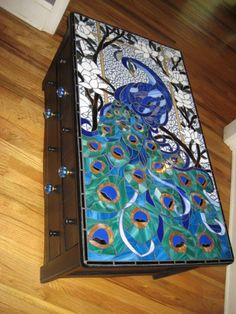 Reserved for Anita. As soon as I saw this 2-drawer chest, I knew I wanted to mosaic the top of it! I painted it glossy black, and pulled parts of pictures I liked together to create a pattern. It took several months to complete and I'm real happy with the results.