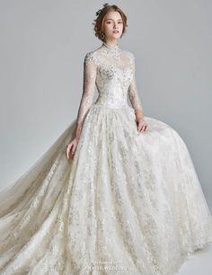 This high-neck wedding dress from Jubilee Bride features a timeless silhouettes with delicate glittering lace details!
