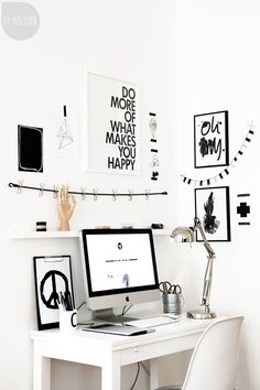 Simple office/workspace, love the black and white decor and the quote on the wall