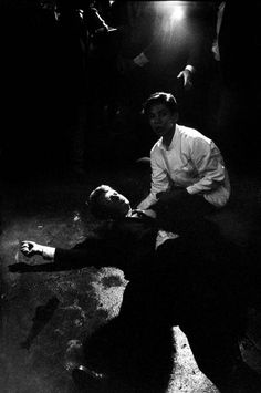 <b>1968</b> | Senator Robert Kennedy lies in a pool of his own blood on the floor of the kitchen at Los Angeles' Ambassador Hotel, June 5, 1968, after being shot by Jordanian-born assassin Sirhan Sirhan. A dazed, frightened hotel busboy, Juan Romero, tries to comfort the mortally wounded presidential candidate, who died hours later. Robert Kennedy was 42 years old. Originally published in the June 14, 1968, issue of LIFE.