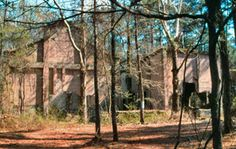 Aldridge Sawmill Historic Site, in the Angelina National Forest. The site includes four buildings: the mill, a power plant, a fuels building and a dry kiln.     While the town itself is gone, the abandoned shells of the four concrete mill buildings, various concrete foundations, the mill pond, and portions of the old railroad tram still remain.    Hikers are welcome but, due to archeological concerns, no off-road vehicles or horses may be ridden in the Aldridge area.