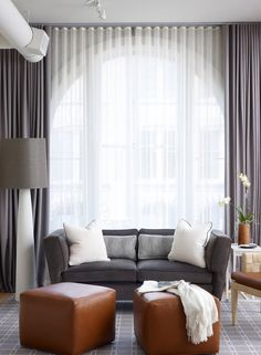 Sheers over Large Window in Living Room Grey and White Ripplefold Drapery and Sheers                                                                                                                                                      More