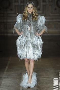 Feather queen  This uber chic look is capped off with house slippers.