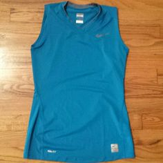 Nike Pro sleeveless top Teal blue Nike Pro sleeveless top with high v neck size Xtra small (0-2.) Excellent condition. Nike Tops Tank Tops