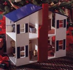 Reader Jim Christian of Vancouver, Washington, designed this dollhouse strictly for kids. The open sides and front make it easy for little arms and fingers to do some all-important interior decorating...