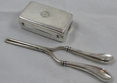 Edwardian sterling silver curling iron and stand by William Davenport, Birmingham 1902