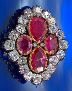 A HISTORICALLY IMPORTANT RUBY AND DIAMOND BROOCH, BAPST, CIRCA 1825. Of quatrefoil design set with pear- and oval-shaped foiled rubies within a surround of cushion-shaped diamonds, accented with two rose-cut stones, engraved to the reverse with a fleur-de-lys. This brooch originally formed part of the ruby and diamond Parure created by Ménière in 1816 to designs by his son-in-law, Evrard Bapst. The Parure was made using stones from the Empress Marie-Louise's Parure, commissioned by Napoleon.