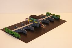 http://www.ebay.com/itm/Ho-Scale-Slot-Car-Scenery-AWESOME-12-STALL-PARKING-LOT-has-RESTROOMS-10-PEOPLE-/282354914223?hash=item41bdaa13af:g:~ogAAOSw9GhYatmU