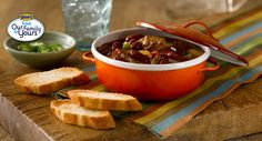 Braised Beef and Bacon Chili Recipe - Bush's Best... Warm up with this flavorful beef stew, slow-cooked with tomatoes, mild spices, and bacon for a delicious smoky flavor.