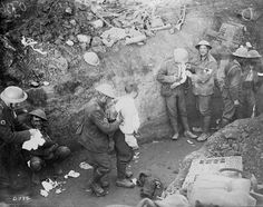 The wounded are dressed in a trench during the Courcelette operation of the Battle of the Somme, France, on 15 September 1916.
