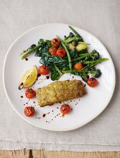 Crumbed Pesto Fish, Roasted Cherry Vines, Spuds and Greens from Jamie Oliver's cookbook Everyday Super Food. This healthy dish provides you with Vitamin C from the tomatoes and Iron from the spinach.