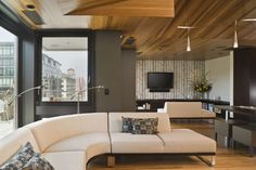 Crane Building Penthouse - contemporary - living room - portland - Giulietti Schouten Architects