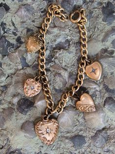 """Sweet Victorian Gold Filled Puffy Heart Charm Bracelet, 5 Repousse Hearts, 3 with Stone Centers, 4 With Names, 7 1/2"""" Curb Link Chain by postGingerbread on Etsy"""