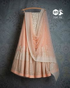 SwatiManish Lehengas SMF LEH 157 18 Peach with white threadwork lehenga and dupa. - SwatiManish Lehengas SMF LEH 157 18 Peach with white threadwork lehenga and dupatta with white sequin threadwork blouse Source by kirenkaurbraich - Half Saree Lehenga, Lehenga Gown, Lehnga Dress, Lehenga Blouse, Indian Lehenga, Anarkali Suits, Indian Bridal Outfits, Indian Fashion Dresses, Indian Designer Outfits