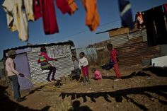 Muhammed Muheisen—AP July 1, 2013. A group of South African girls enjoy skipping a rope in Soweto township, on the outskirts of Johannesburg, South Africa.