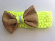 A 3 by 2 bow. This bow is made with REAL retired bunker gear. Hand sewed. Each bow is slightly different from the other. And since it is retired gear it also might have different coloring with each bow. And has a center piece that can be changed! The ones in the picture around are showing neon yellow and thin silver but other options are available if you scroll through the options Center Piece! There is also the examples of what can be in the middle scroll to the 2nd photo and you can see…