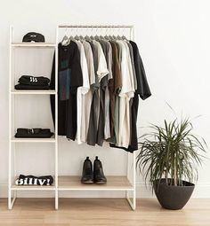 14 clothes racks that store your garments in style - White and wood clothing rack Clothes racks are excellent storage solutions for bedrooms, entryways, laundry rooms and guestrooms. They give you easy access to all your garments, and they ar Wood Clothing Rack, Diy Clothes Rack, Clothes Stand, Clothes Rack Bedroom, White Clothing Rack, Portable Clothes Rack, Open Wardrobe, Wardrobe Closet, Wardrobe Storage