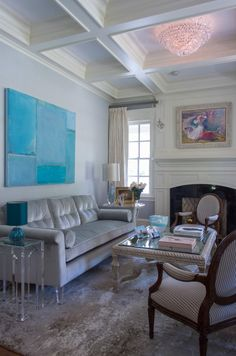 A Piece of Art by Dusty Griffith takes Center Stage in the Formal Sitting Room.