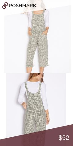 TOPSHOP | DAISY PRINT PINAFORE JUMPSUIT Soft and light viscose fabric| Fine floral prints all over|Square neck and broad shoulder straps Adjustable self-tie belt to waist |  Dual side slide-in pockets| Back concealed zipper closure| Wide leg culotte pants| new missing tags | excellent condition| Topshop Pants Jumpsuits & Rompers
