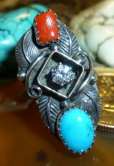 Very unusual vintage Native made ring has a cubic zirconia set in it! Never Worn New Old Stock 1960s: Navajo Sterling Gem Ring Red Coral, CZ Gem & Blue Turquoise Sz 8 $174.95 or best offer ...