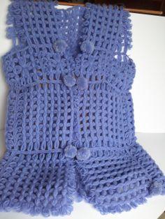 Gilet lungo di lana fatto a mano con la tecnica dei telai