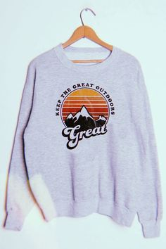 Great Outdoors Pullover Keep the great outdoors great. This lightly distressed graphic crewneck sweatshirt has a vintage look and feel. With a vibrant and colorful mountain graphic, take it with you on all your adventures. Fleece Pullover, Pullover Outfit, Crew Neck Sweatshirt Outfit, Earl Sweatshirt, Vintage Crewneck Sweatshirt, Graphic Sweatshirt, Cute Sweatshirts, Sweatshirts Vintage, Style Clothes