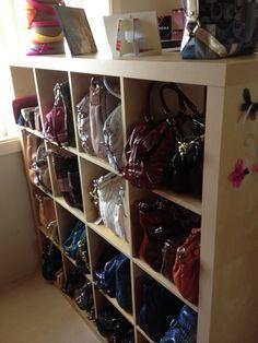 Purse storage idea...love the shelving unit.
