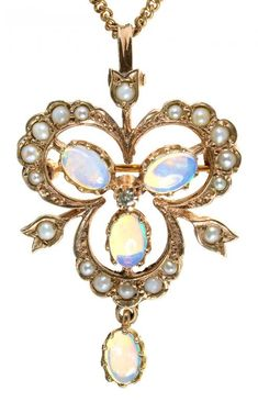 AN OPAL, DIAMOND AND SPLIT PEARL OPENWORK PENDANT IN 9CT GOLD, ON GOLD NECKLET  Sold @ Mellors & Kirk