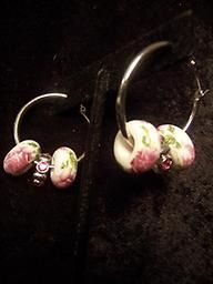 Small floral hoop earrings.  Great for work, or anytime really.  Stay stylish!