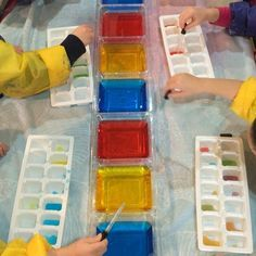 Our younger preschoolers work on their fine motor skills while exploring color theory.  #playmatters #preschool #mixingcolors #eyedropperfun