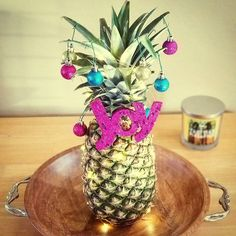 dont have space for a christmas tree decorate a pineapple instead several