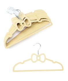 This Ivory Bow Hanger - Set of 10 by Beriwinkle is perfect! #zulilyfinds