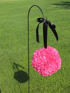 Hot pink and black tissue paper pomander :  wedding black hot pink pomander shepherds hook tissue paper  you could do it with different colors