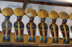 """""""© Heidi Kontkanen. Frieze of cobras. A frieze of uraei, or cobras, with solar disks. Detail from the gilded canopic shrine that had the alabaster chest that contained the four canopic miniature coffins of Tutankhamon. 18th dynasty, from Valley of the Kings - KV62. JE 60686. Upper floor, gallery 9. Cairo Museum"""" ^**^"""