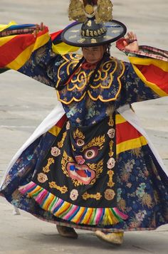 gardenofthefareast:  Festival Dancer by bleung Tsechu festival is an annual religious Bhutanese festival held in each district of Bhutan on the tenth day of a month of the lunar Tibetan calendar. The dancer put on a very colorful costume and hat.