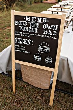 A buffet is casual and laid-back, just like your backyard. Besides, who doesn't love a good burger? Give your guests a peek at the comfort foods that await them by writing the menu on a chalkboard.Related: 50 Fun Menu Innovations for Your Reception