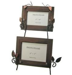@Overstock - A black finish is featured on this pair of wooden photo frames. These photo frames also showcase a nature-inspired, double metal easel with an organic leaves and twig design in black and copper patina finish accented with clear beads.http://www.overstock.com/Home-Garden/Twigs-and-Leaves-Metal-Easel-Double-Photo-Frame/6308414/product.html?CID=214117 $32.99