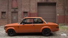 Petrolicious carves up the road with a pumpkin-colored BMW 2002
