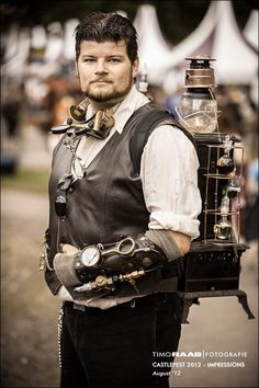 The steampunk man behind the steampunk woman by Firefly182.deviantart.com on @deviantART