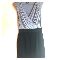 Black and grey ladies dress Gray and black dress in excellent condition. Banding at the waist. Capped sleeves with stud detail. Allen B Dresses