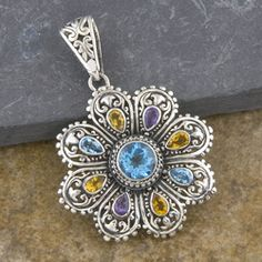 @Overstock - Explore the beauty of Indonesian handcrafts with this striking blue topaz, citrine and amethyst  sterling silver cawi pendant. This handcrafted pendant will add a delicate elegance to any outfit on any occasion.http://www.overstock.com/Worldstock-Fair-Trade/Sterling-Silver-Multi-Gemstone-Cawi-Pendant-Indonesia/6393905/product.html?CID=214117 $93.99