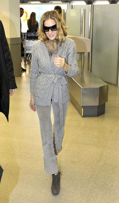 Sarah Jessica Parker Wrap Top - Sarah Jessica wears a cable knit wrap sweater with some gray cuffed cords to the airport.