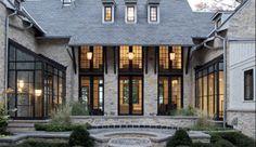 black windows, stone walls, slate roof! light eaves