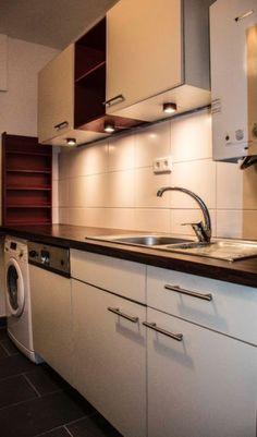 Ein sehr eleganter und schlichter Küchenschrank, der doch mit viel ...