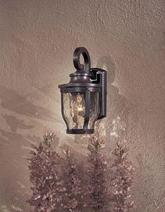 "Minka Lavery Outdoor Merrimack 8761-166 Cast Aluminum 1-LT 100w (12""H x 6""W) Wall Lighting in Bronze by Minka Great Outdoors. $67.90. The Minka-Lavery Outdoor 8761-166 is a Medium Wall Mount Light Fixture from the Merrimack Collection. Merrimackis a sturdy cast aluminum family that has features and style that are exhibited in the finest outdoor fixtures. The Corona Bronzeis highlighted by Clear Hammered Glass and is priced to fit every budget. This Lighting Fixture is..."