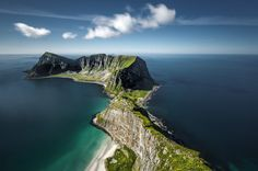 An aerial view of the southern end of Værøy, one of Norway's Lofoten Islands, reveals a towering ridge running through it like a bony spine. Værøy is home to a population of fewer than 800 people but millions of nesting seabirds, and it frequently hosts bird-watchers who flock to the island by helicopter or ferry.