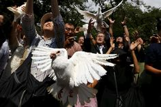 People release doves as a symbol of peace at Yasukuni Shrine on the anniversary…